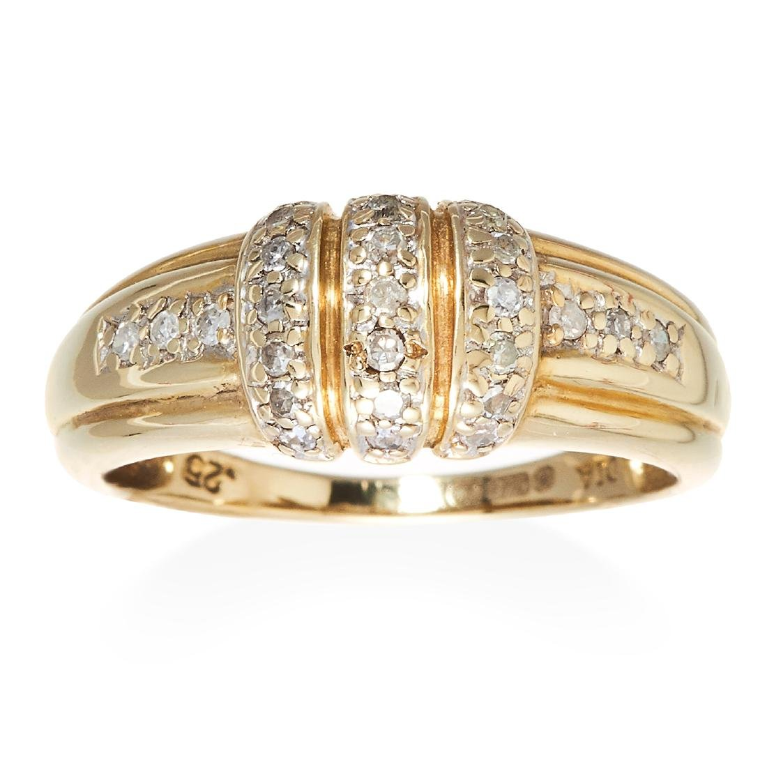 A DIAMOND DRESS RING in 9ct yellow gold, jewelled with