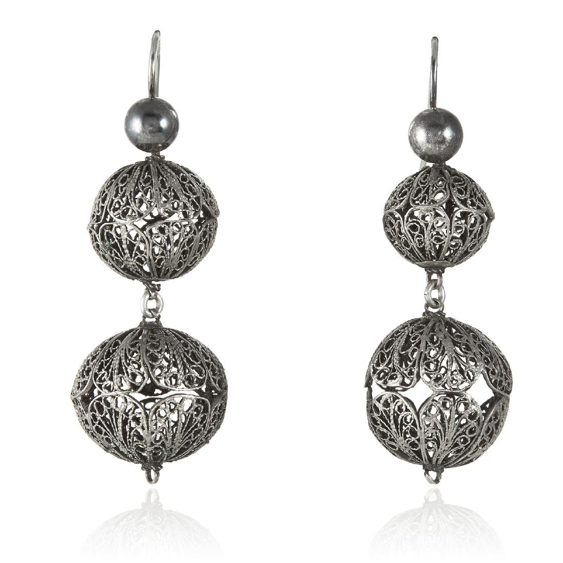 A PAIR OF FILIGREE EARRINGS in silver, designed as a