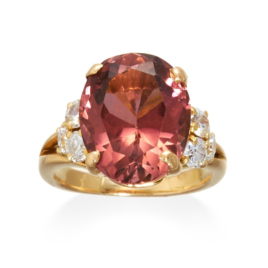 A TOURMALINE AND DIAMOND DRESS RING in yellow gold,