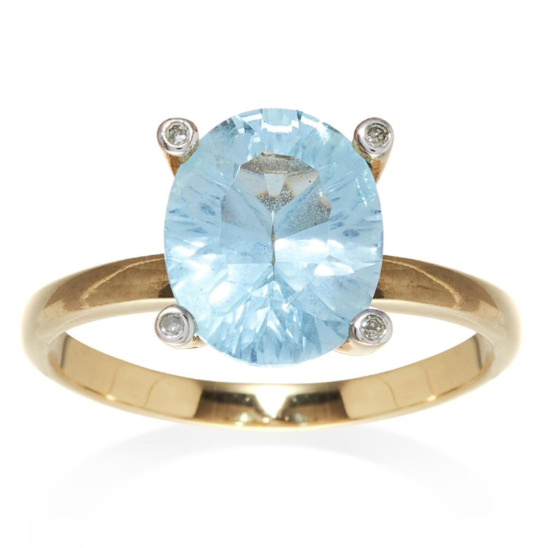 A TOPAZ AND DIAMOND DRESS RING in 9ct yellow gold, set