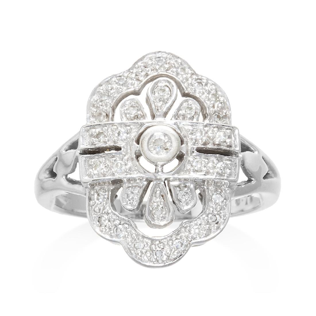 A DIAMOND DRESS RING in 9ct white gold, designed in Art