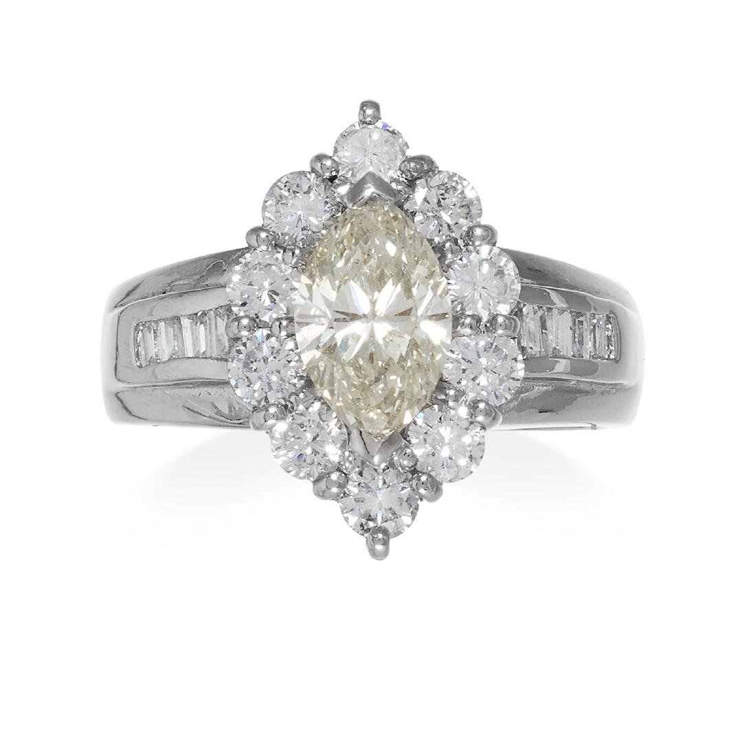 A DIAMOND DRESS RING in platinum, comprising of a