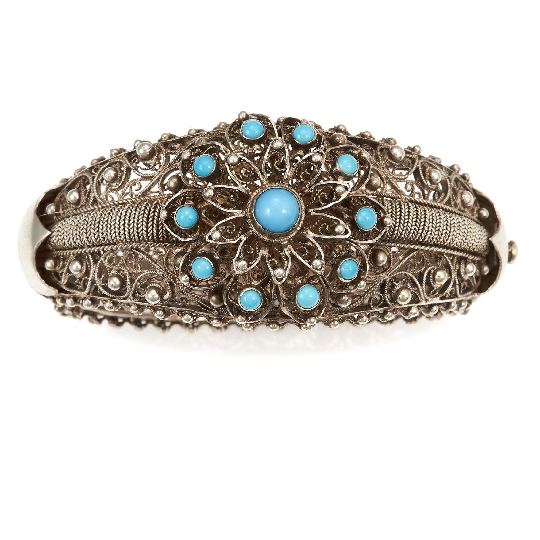 A TURQUOISE BANGLE, TOPAZIO in silver gilt, set with a