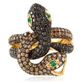 A COLOURED DIAMOND AND EMERALD DOUBLE SNAKE RING in