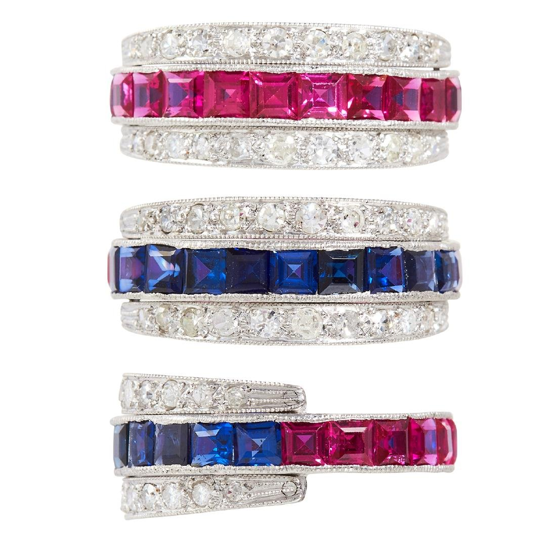 A SAPPHIRE, RUBY AND DIAMOND REVERSIBLE RING in