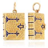 AN ANTIQUE ENAMEL BOOK LOCKET in high carat yellow