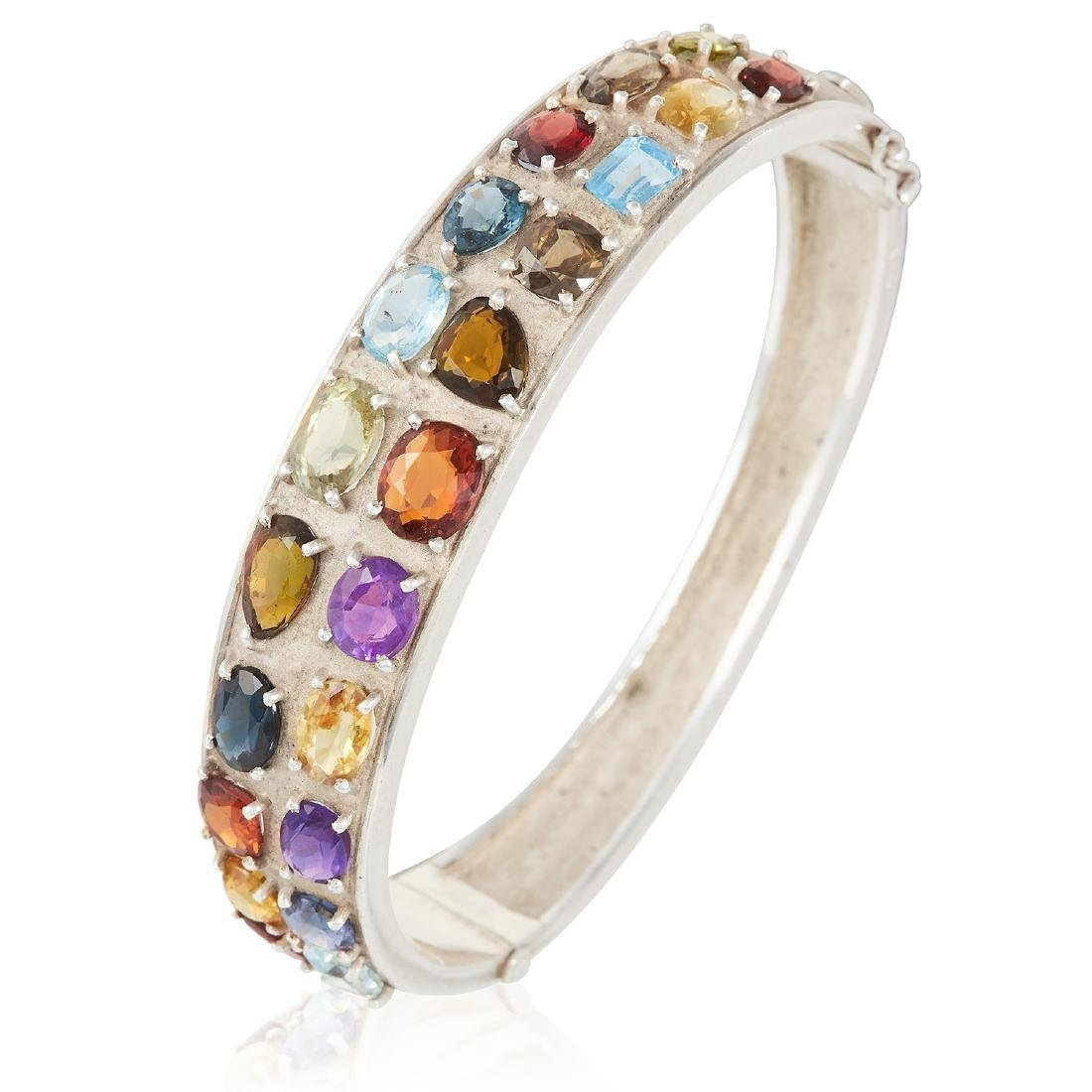 A GEM SET BANGLE in sterling silver, set with various