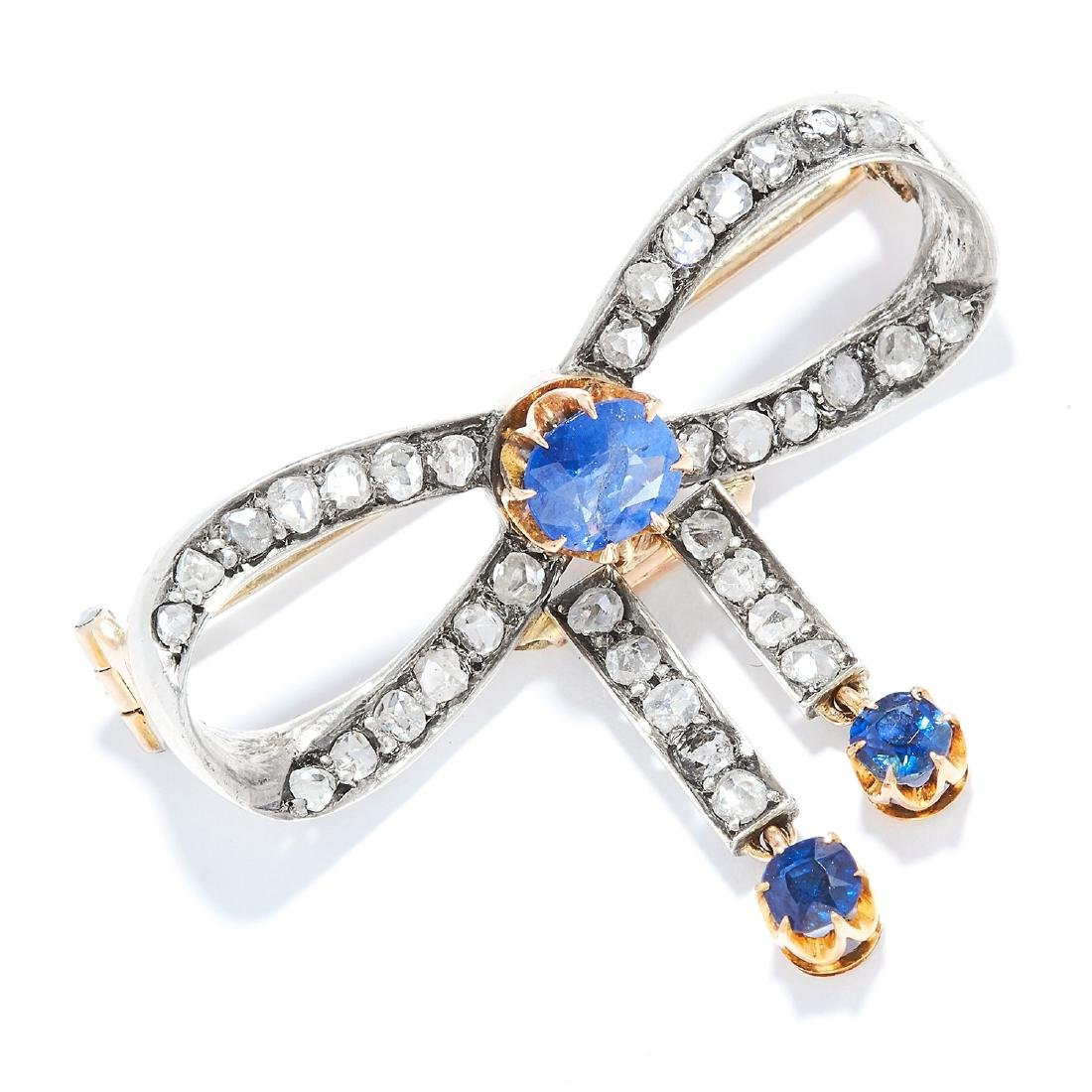 AN ANTIQUE SAPPHIRE AND DIAMOND BOW BROOCH in yellow