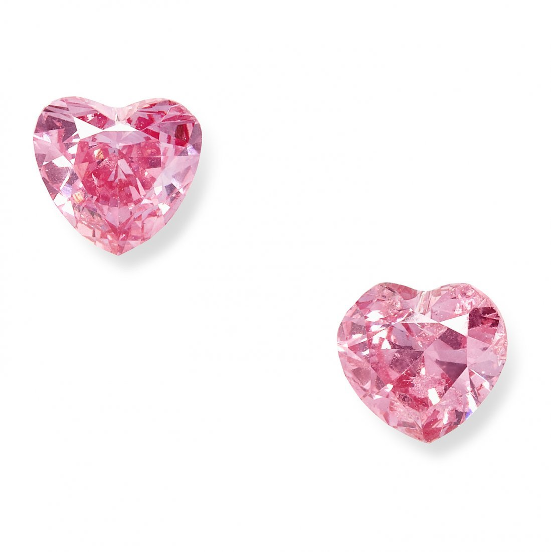 A PAIR OF 0.54 CARAT FANCY VIVID PURPLISH PINK DIAMOND