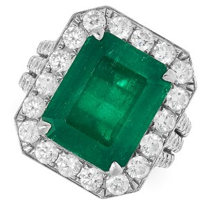 A 7.69 CARAT COLOMBIAN EMERALD AND DIAMOND RING set