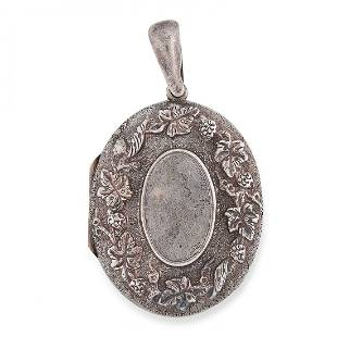 ANTIQUE SILVER LOCKET in foliate design opening to