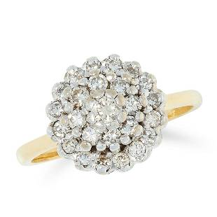 A DIAMOND CLUSTER RING set with a cluster of round cut