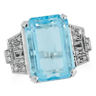 A TOPAZ AND DIAMOND RING set with an emerald cut topaz
