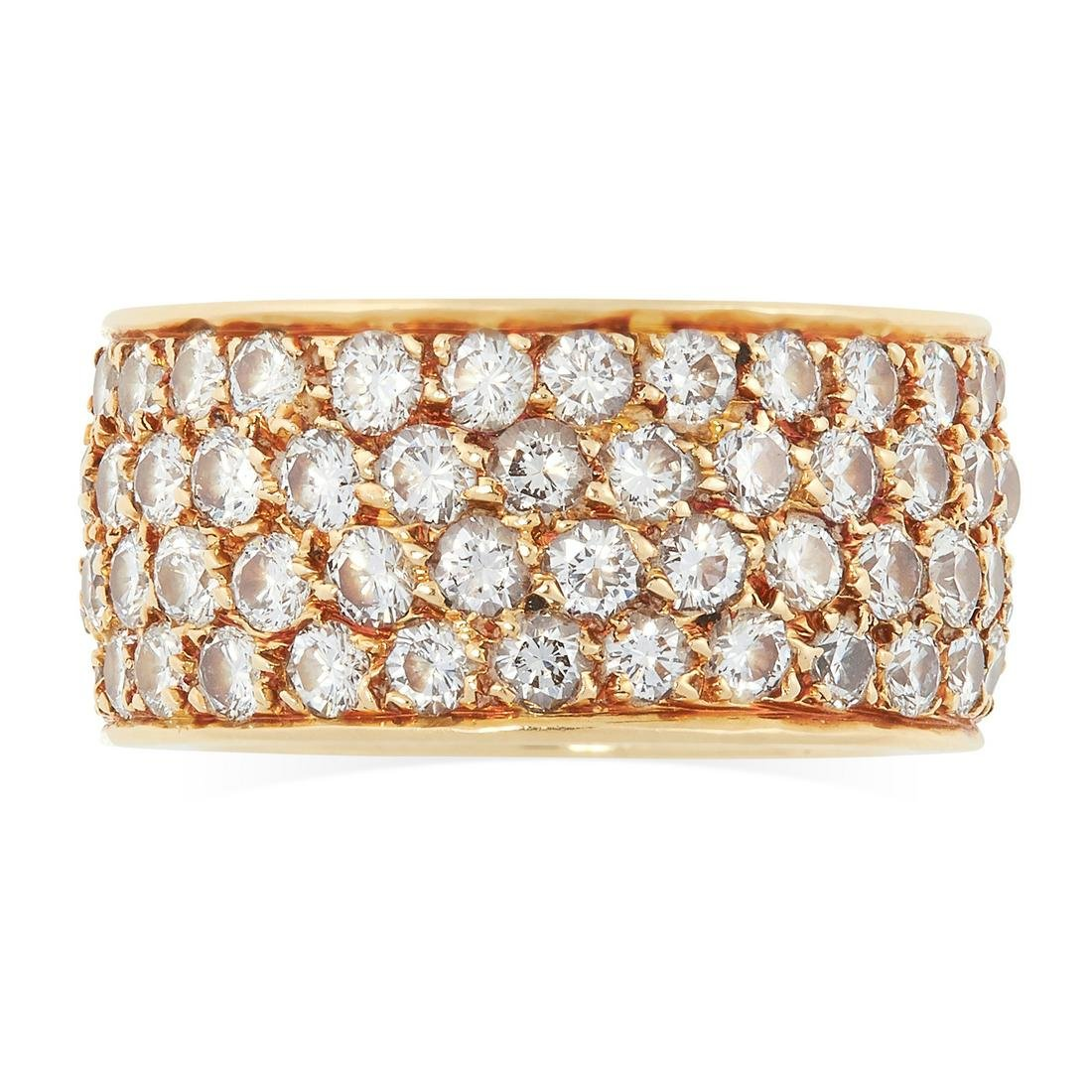 A VINTAGE DIAMOND ETERNITY BAND RING, VAN CLEEF &