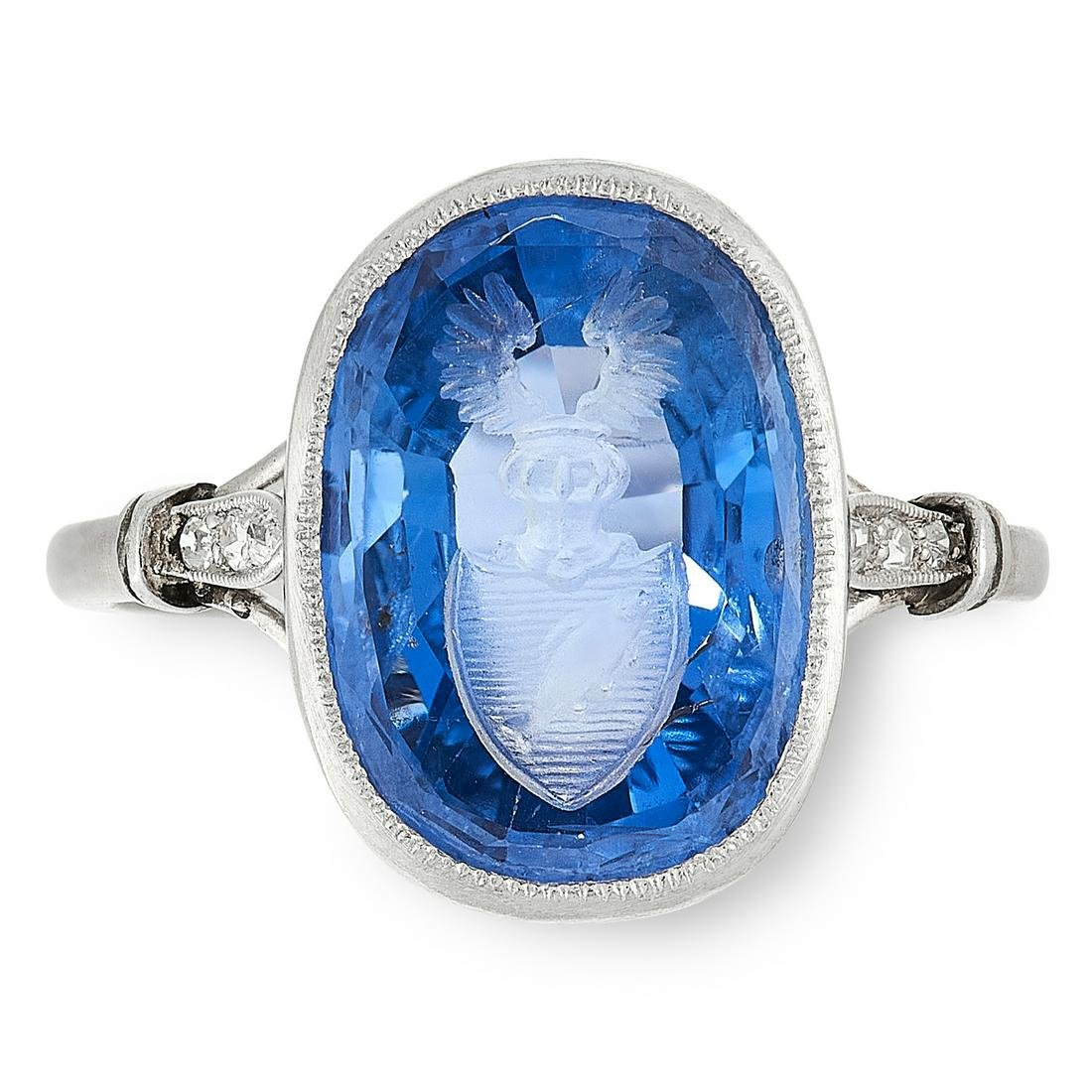 A CEYLON NO HEAT SAPPHIRE INTAGLIO AND DIAMOND SEAL