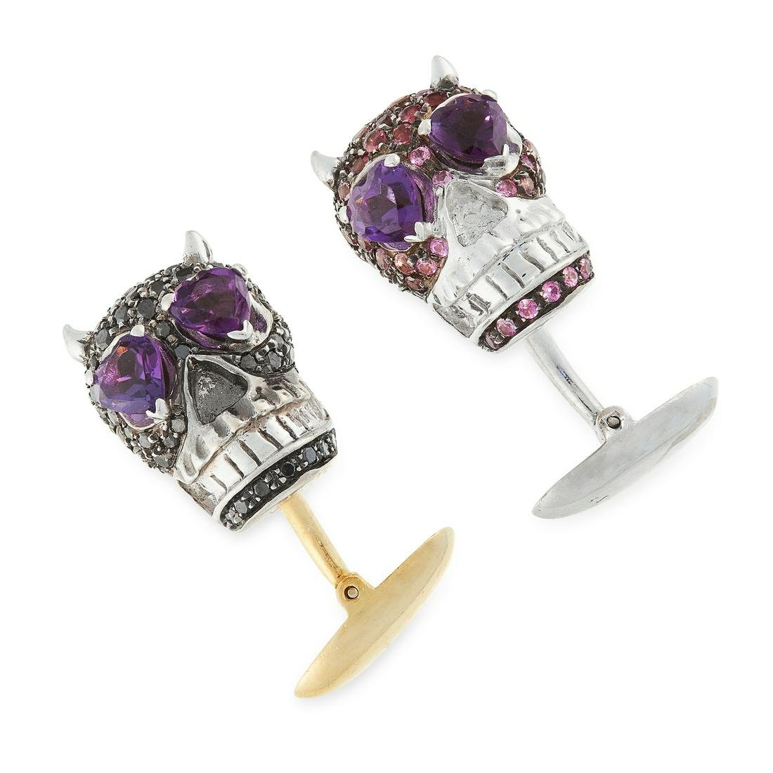 A PAIR OF GEMSET SKULL CUFFLINKS in 18ct gold, in the
