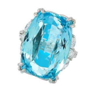 AN AQUAMARINE AND DIAMOND DRESS RING in platinum, set