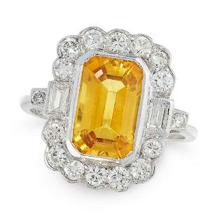 A VINTAGE YELLOW SAPPHIRE AND DIAMOND DRESS RING in