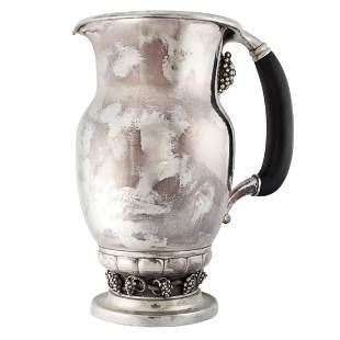 A VINTAGE GRAPE JUG / PITCHER, GEORG JENSEN in silver,