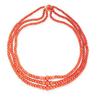 A CORAL BEAD NECKLACE in 18ct yellow gold, comprising