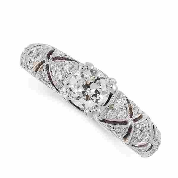 A DIAMOND RING in 18ct white gold, set with a central