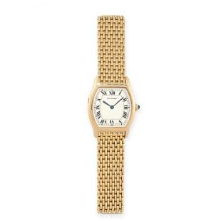 A TORTUE WRIST WATCH, CARTIER in 18ct yellow gold, 26mm