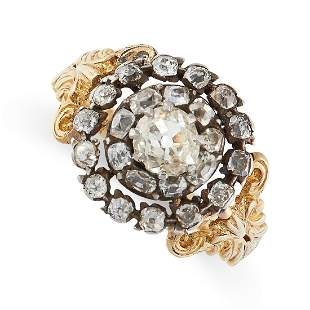 AN ANTIQUE DIAMOND RING in 18ct yellow gold and silver,