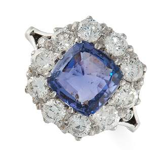 A SAPPHIRE AND DIAMOND RING in 18ct white gold, set