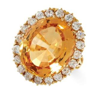 AN IMPERIAL TOPAZ AND DIAMOND RING in 18ct yellow gold,