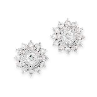 A PAIR OF DIAMOND EARRINGS each formed of a cluster of