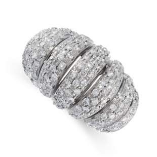 A DIAMOND RING in 18ct white gold, of bombe design,