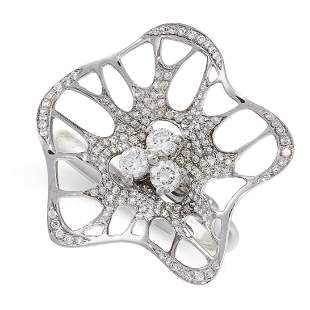 A DIAMOND RING in 18ct white gold, designed as an