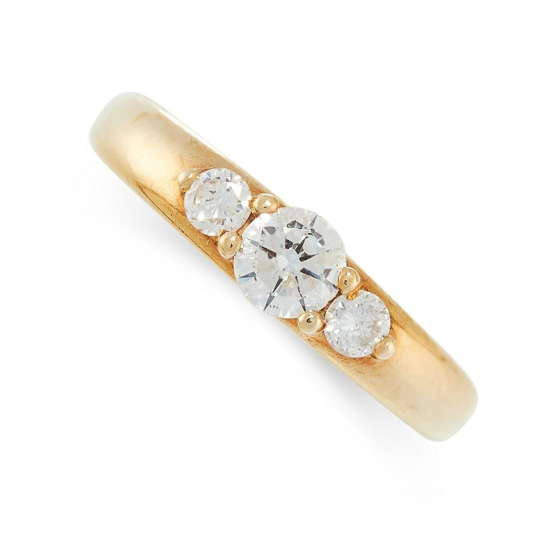 A DIAMOND THREE STONE RING in 18ct yellow gold, set