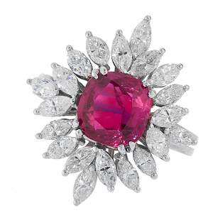 AN UNHEATED RUBY AND DIAMOND RING in platinum, set with