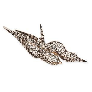 A DIAMOND AND EMERALD BIRD BROOCH designed as a
