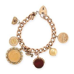 A VINTAGE GOLD CHARM BRACELET the curb link bracelet