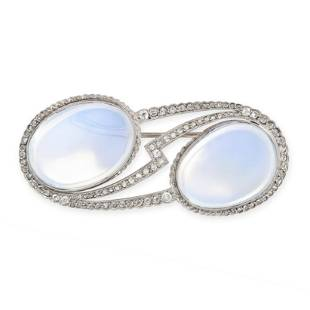 AN ART DECO MOONSTONE AND DIAMOND BROOCH set with two