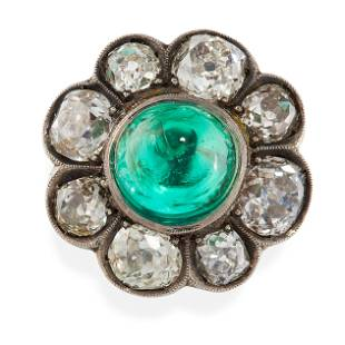 AN ANTIQUE EMERALD AND DIAMOND RING in yellow gold, set