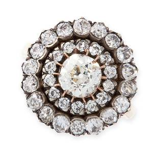 A DIAMOND CLUSTER RING in yellow gold and silver, set