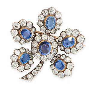 AN ANTIQUE SAPPHIRE AND DIAMOND FLOWER BROOCH in yellow