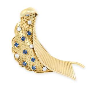 A VINTAGE SAPPHIRE AND DIAMOND BROOCH, CARTIER in 18ct
