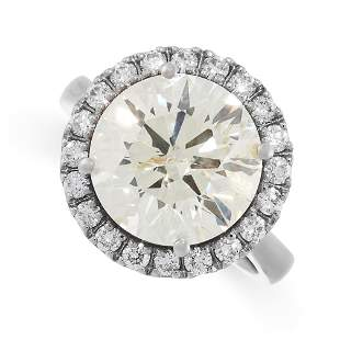 A SOLITAIRE DIAMOND ENGAGEMENT RING in 18ct white gold,
