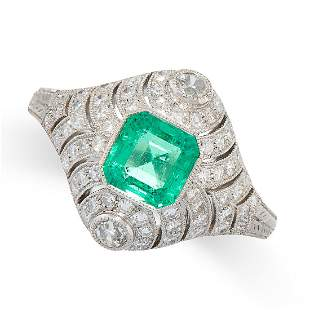 AN EMERALD AND DIAMOND RING in platinum, set with an