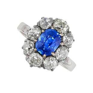 A KASHMIR SAPPHIRE AND DIAMOND RING in 18ct gold, set