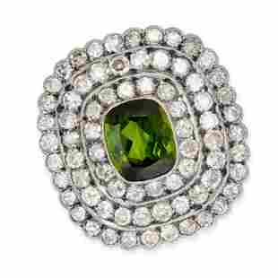 A GREEN TOURMALINE AND DIAMOND BROOCH, CIRCA 1930 set