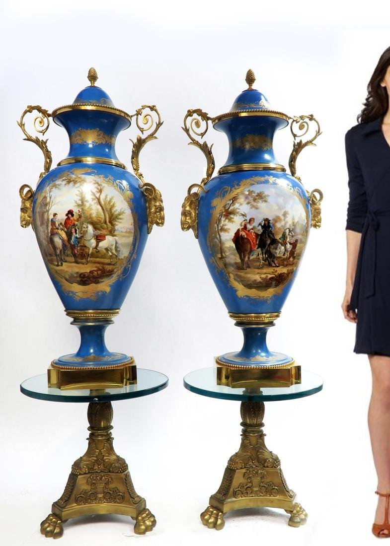A Pair of Monumental Bronze Mounted Sevres Vases