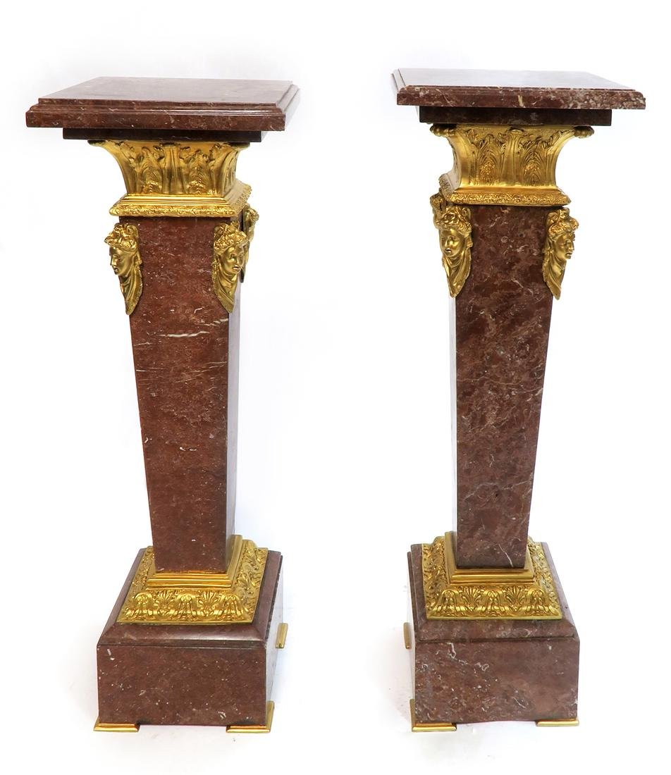A Pair of Bronze Mounted Rouge Marble Pedestals