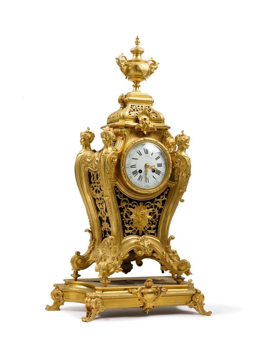 A Louis XVI style Bronze Clock on Tray
