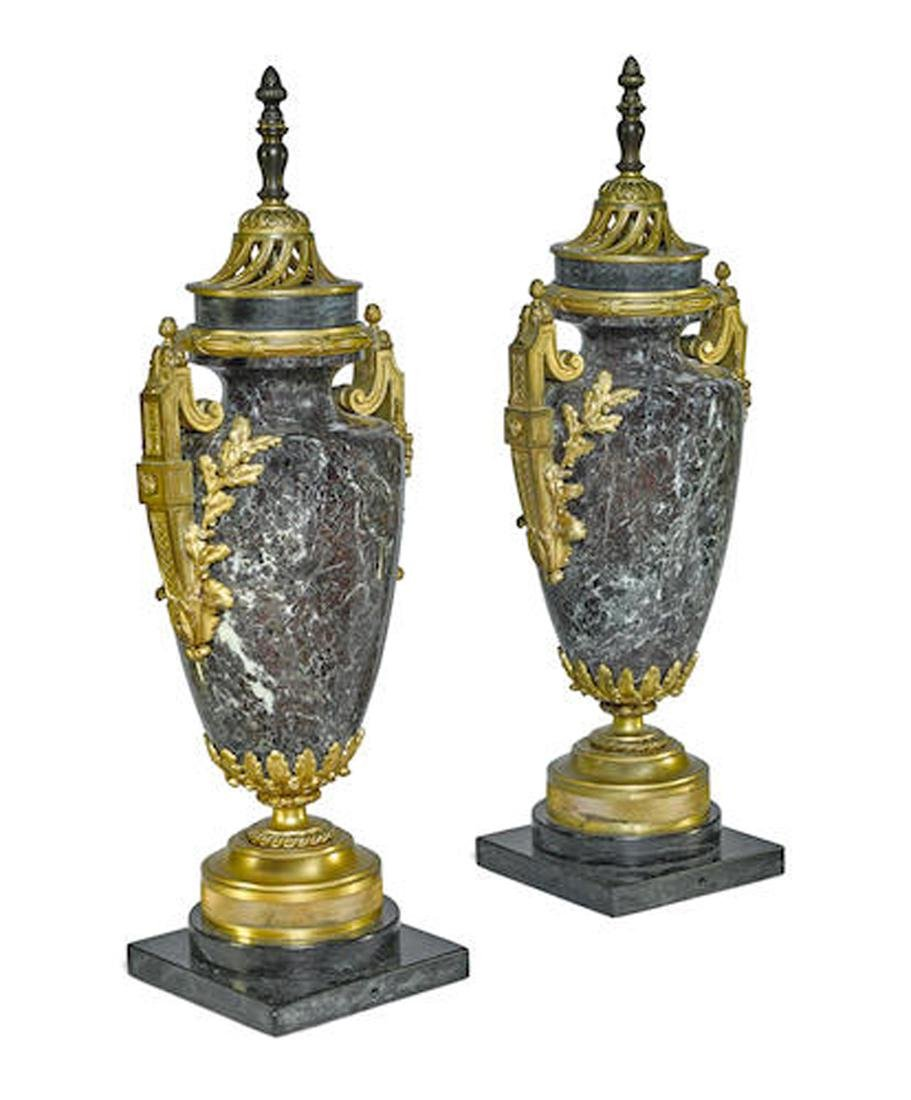 A PAIR OF FRENCH GILT BRONZE MOUNTED MARBLE URNS