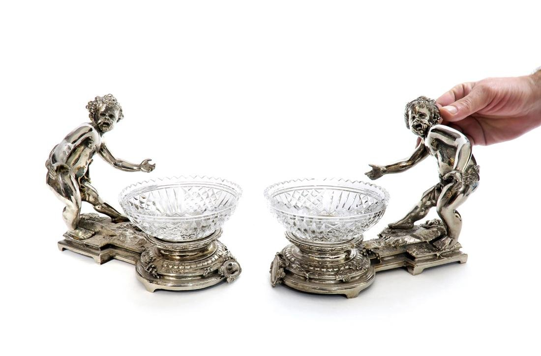 A Pair of Silver Plated & Baccarat Figural Garnitures